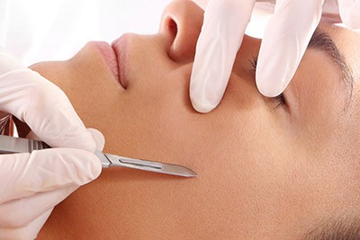 Dermaplaning exfoliation taking place